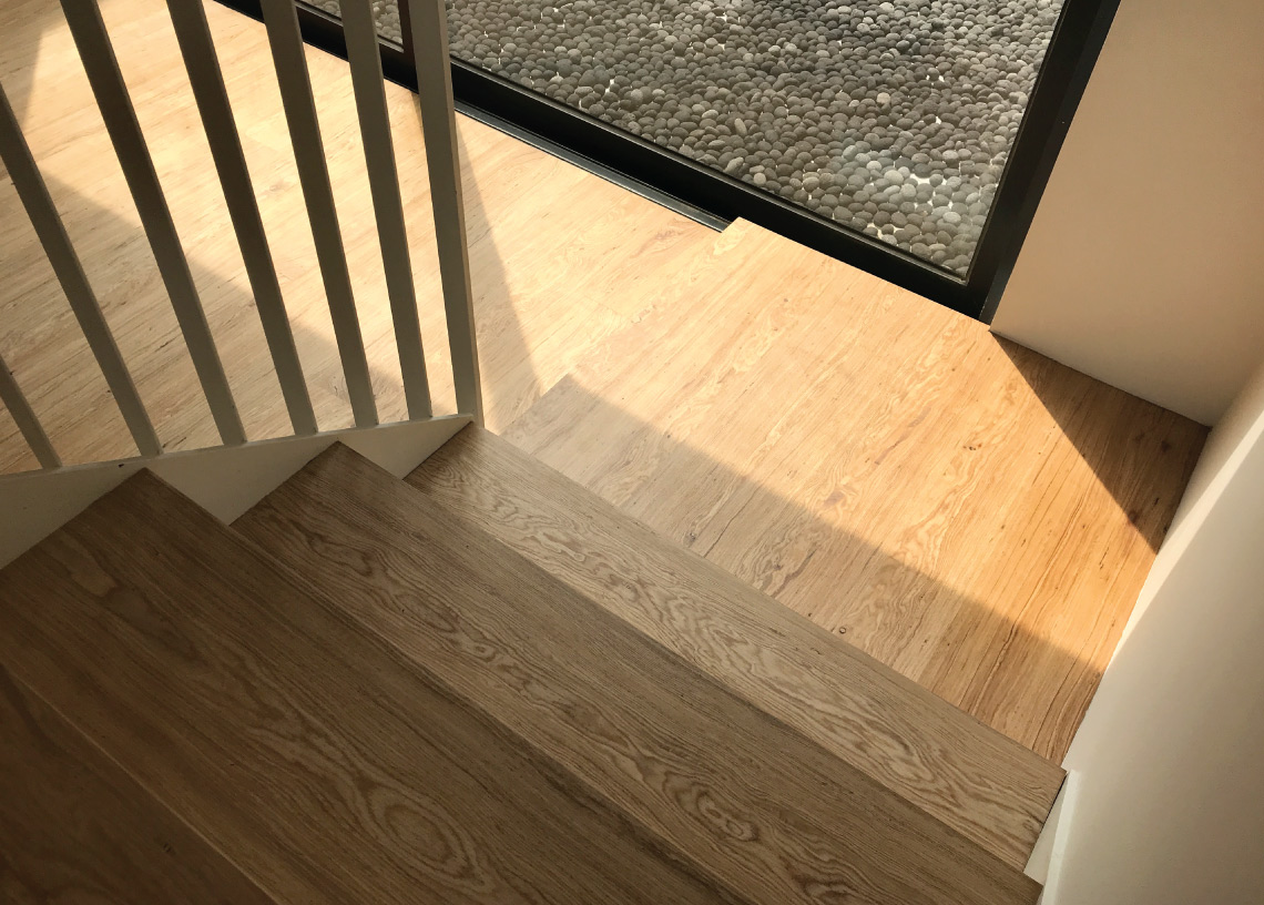 Onewood Solid Timber Flooring with Staircase Tread and Landing at Bungalow